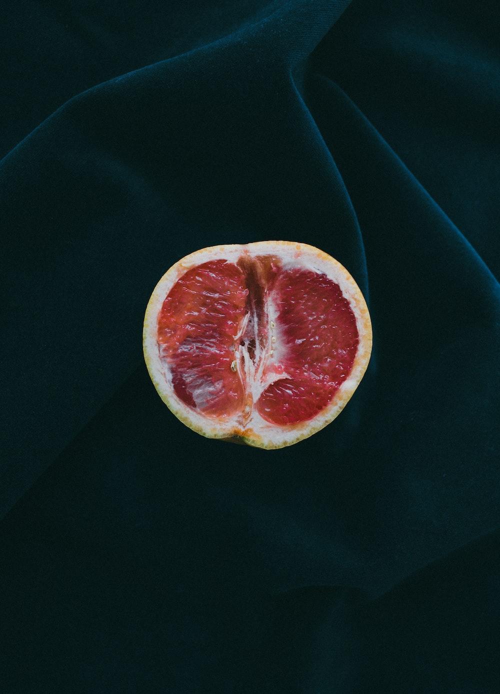 grapefruit on black surface