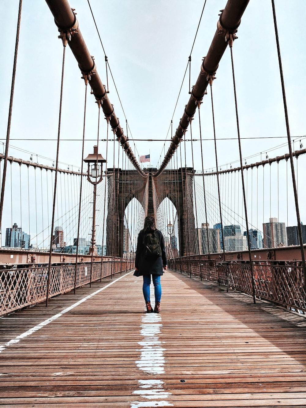 woman standing in bridge