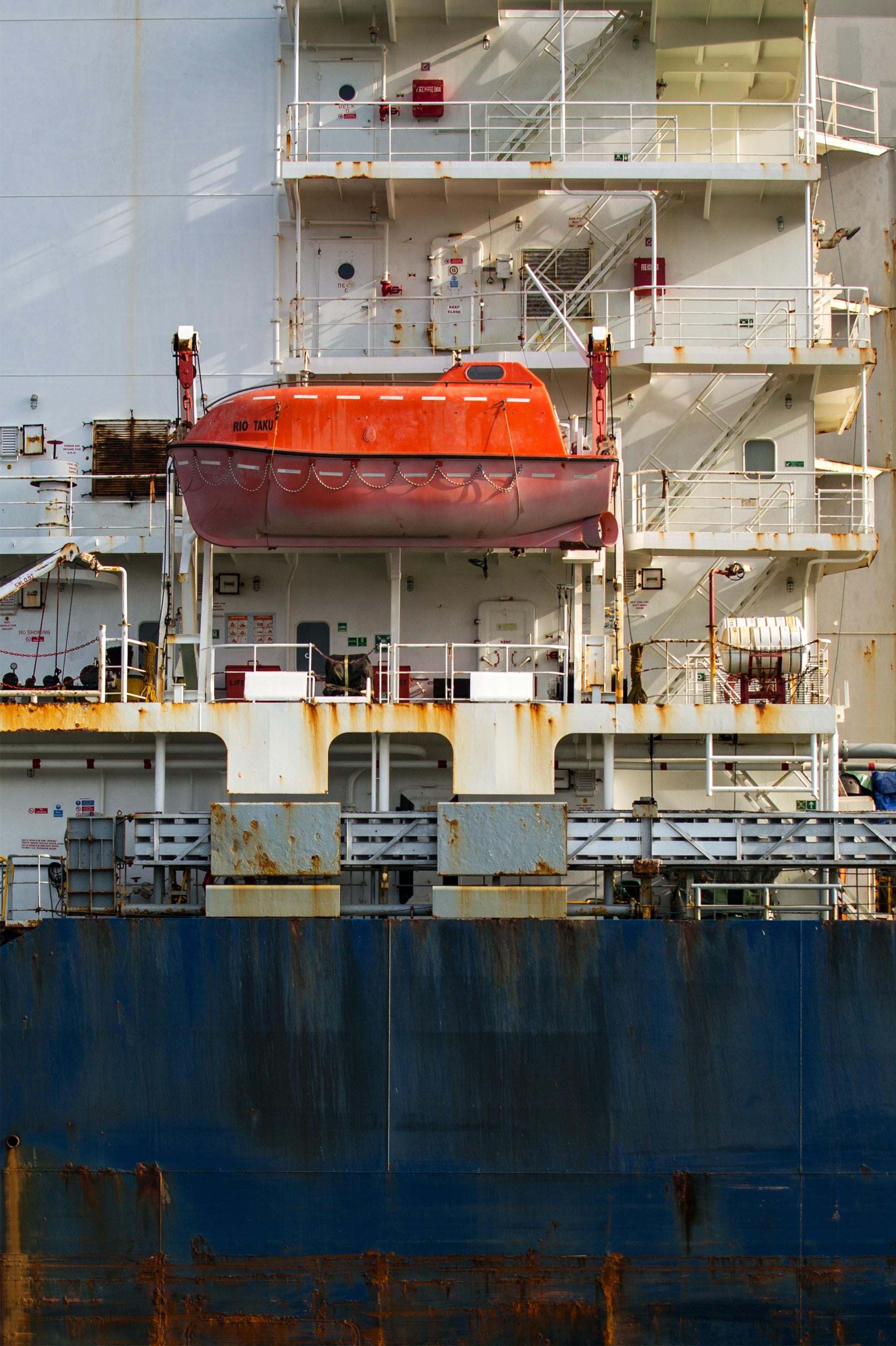 low angle photo ofwhite concrete boat