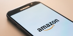 black Samsung Galaxy smartphone displaying Amazon logo