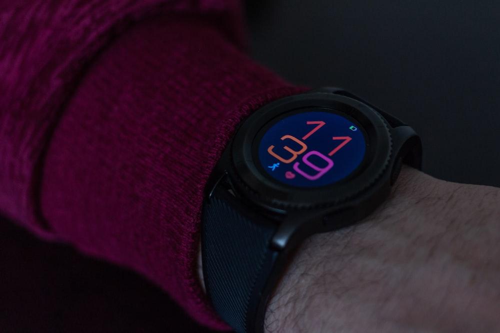 black smartwatch showing 11 39