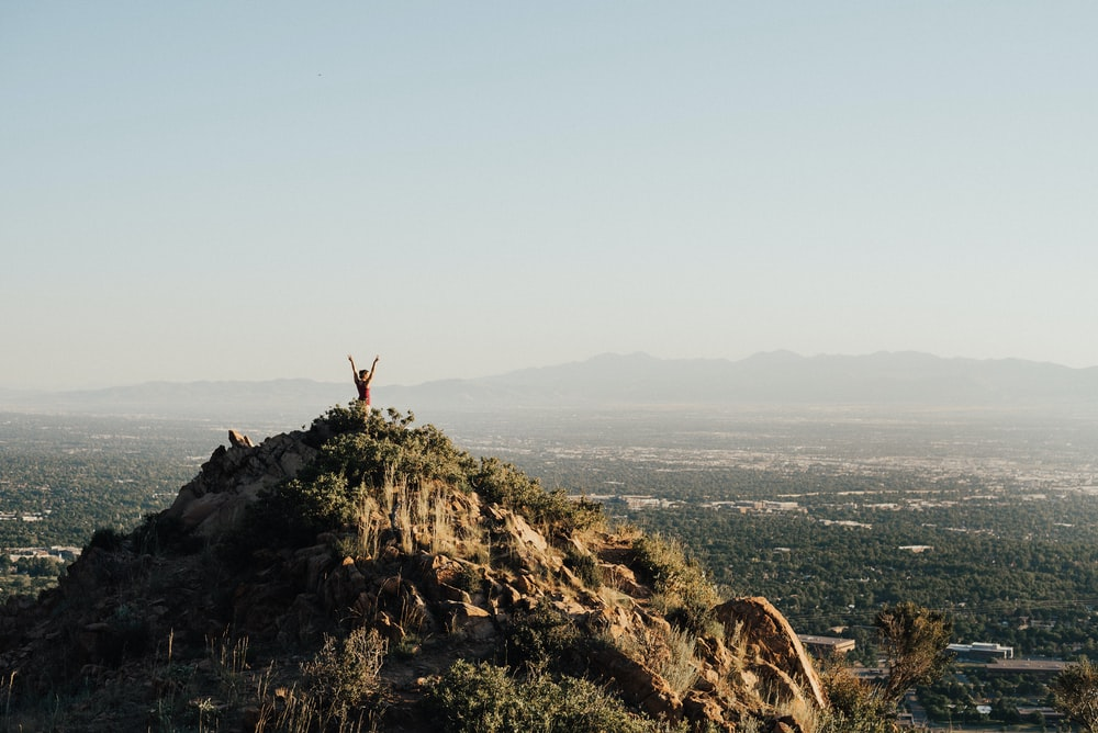 person on top mountain