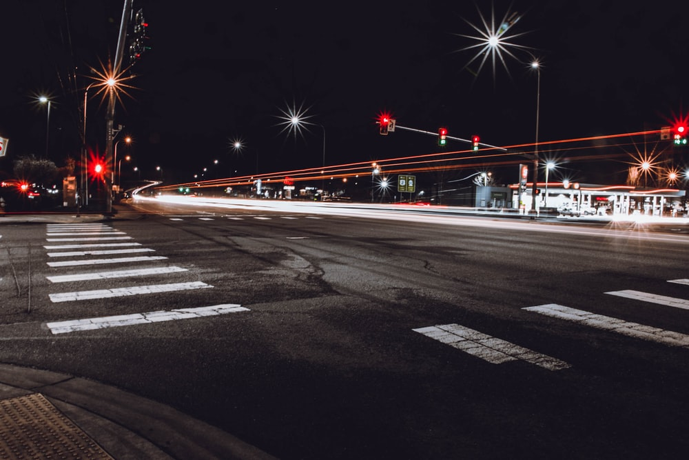time lapse photo of concrete pavement during night