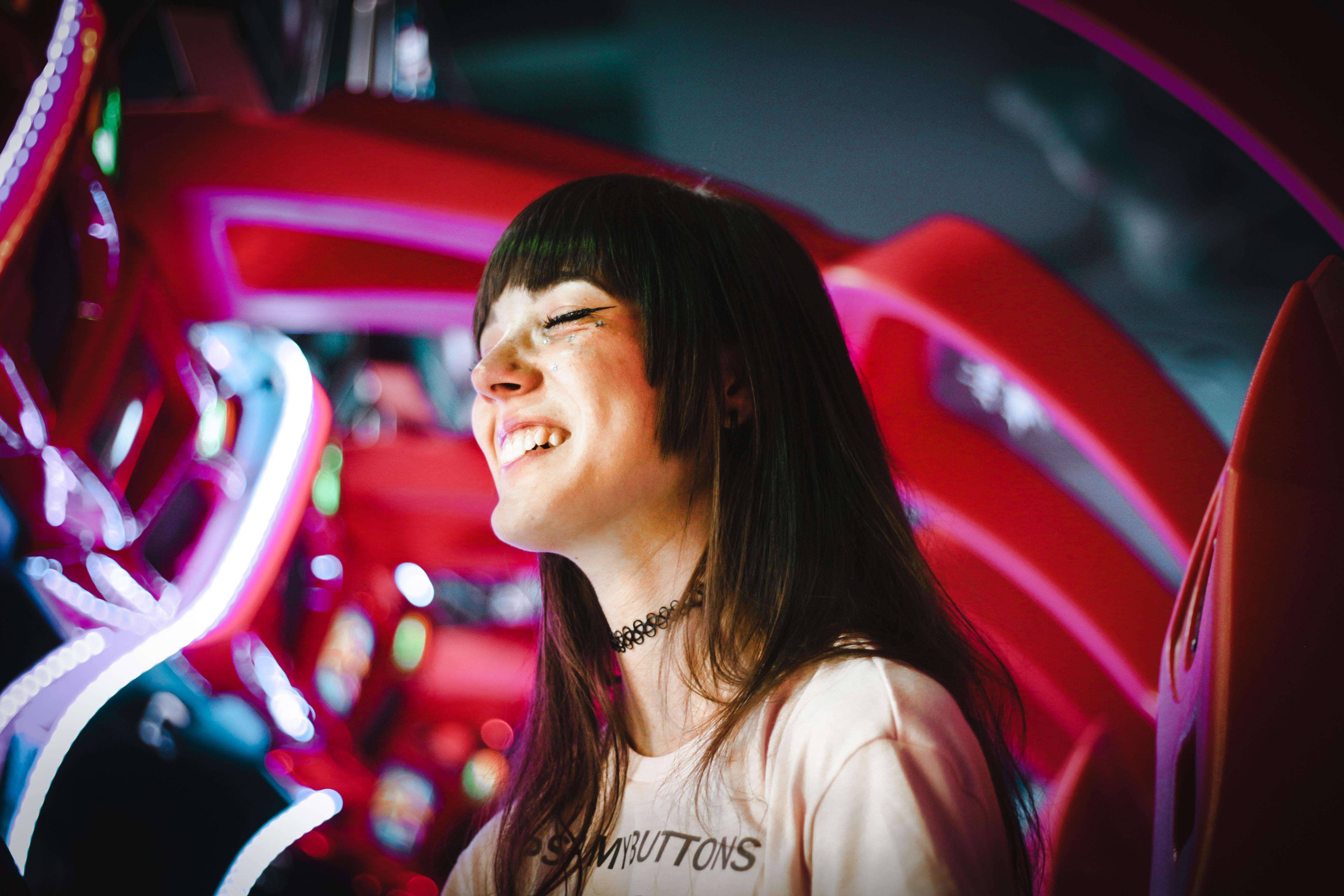 photo of smiling woman wearing black choker