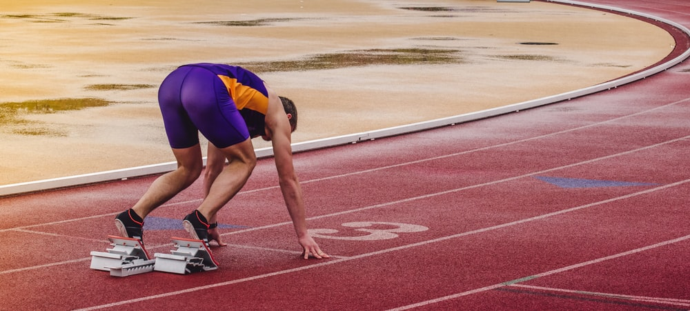 man preparing for race at oval track