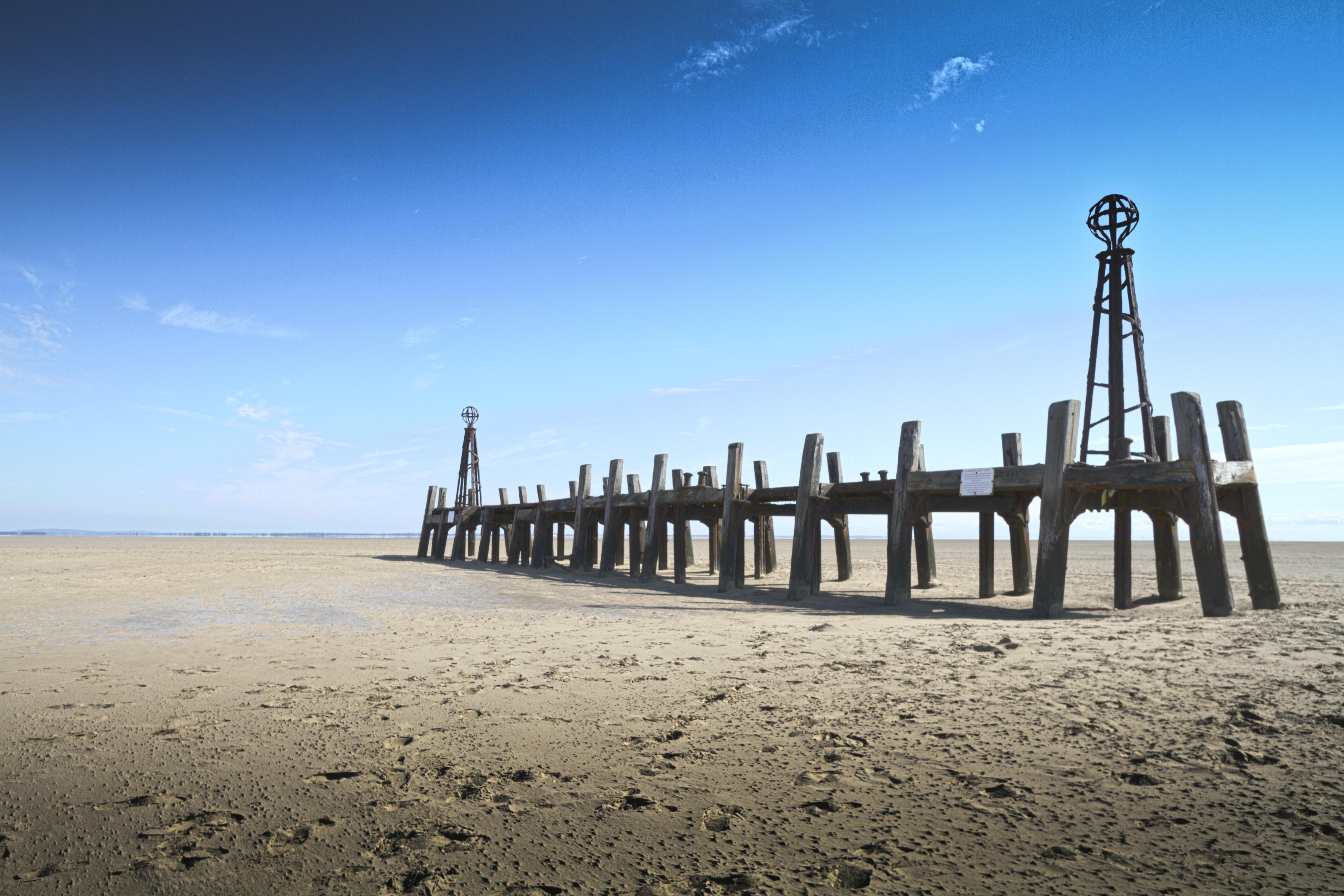 photo of brown dock on shoreline