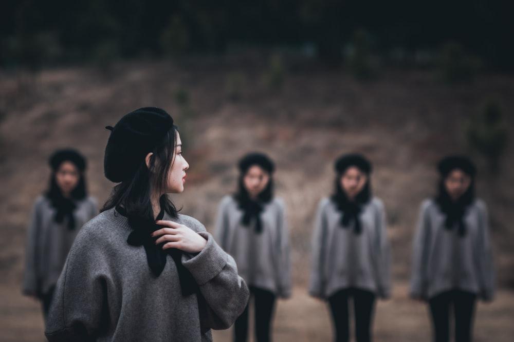woman wearing knit cap looking backward