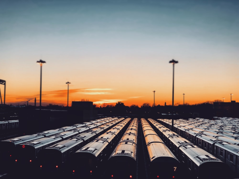 train wagons parked in parking during sunset