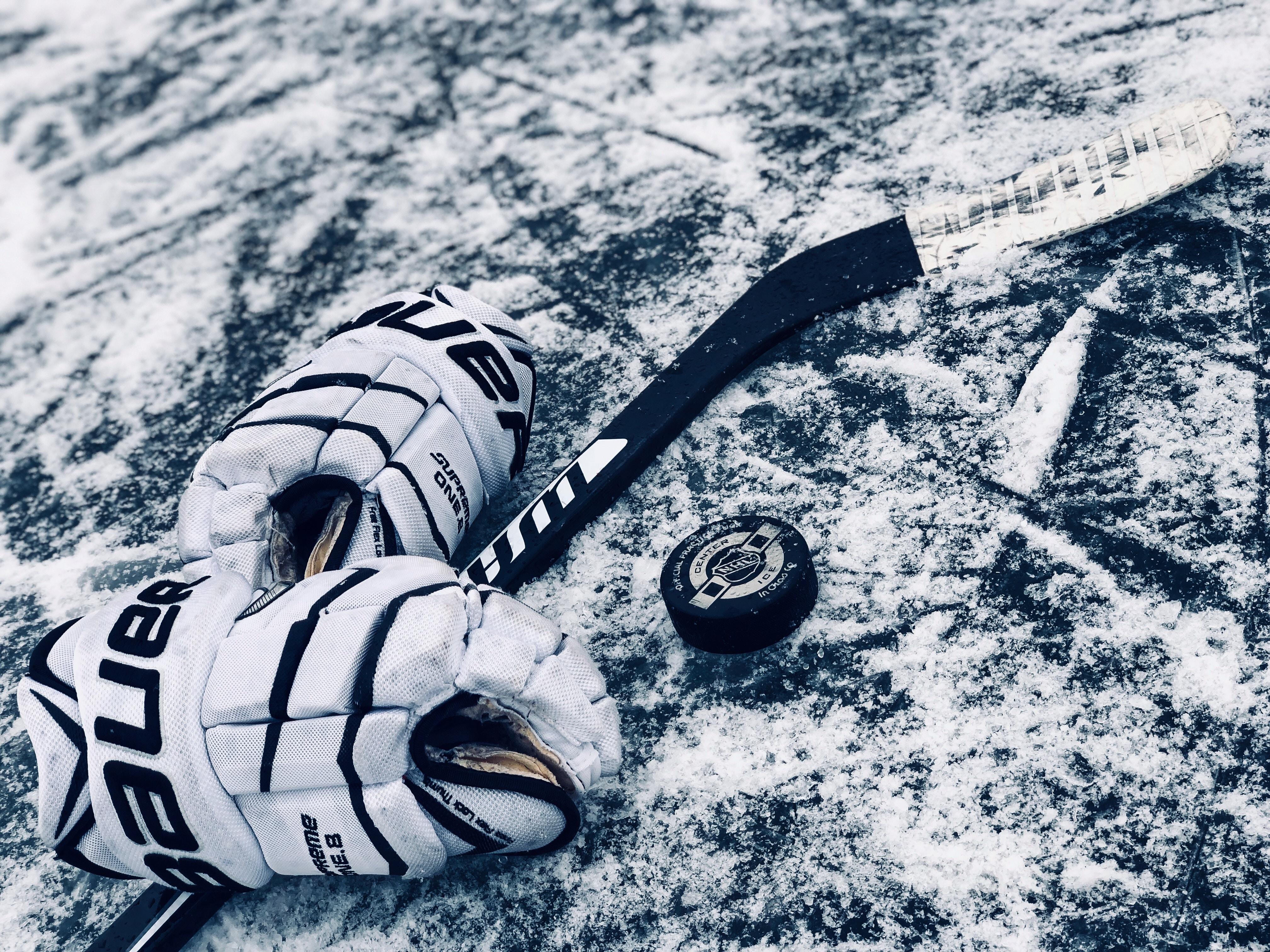 black ice hockey beside gloves