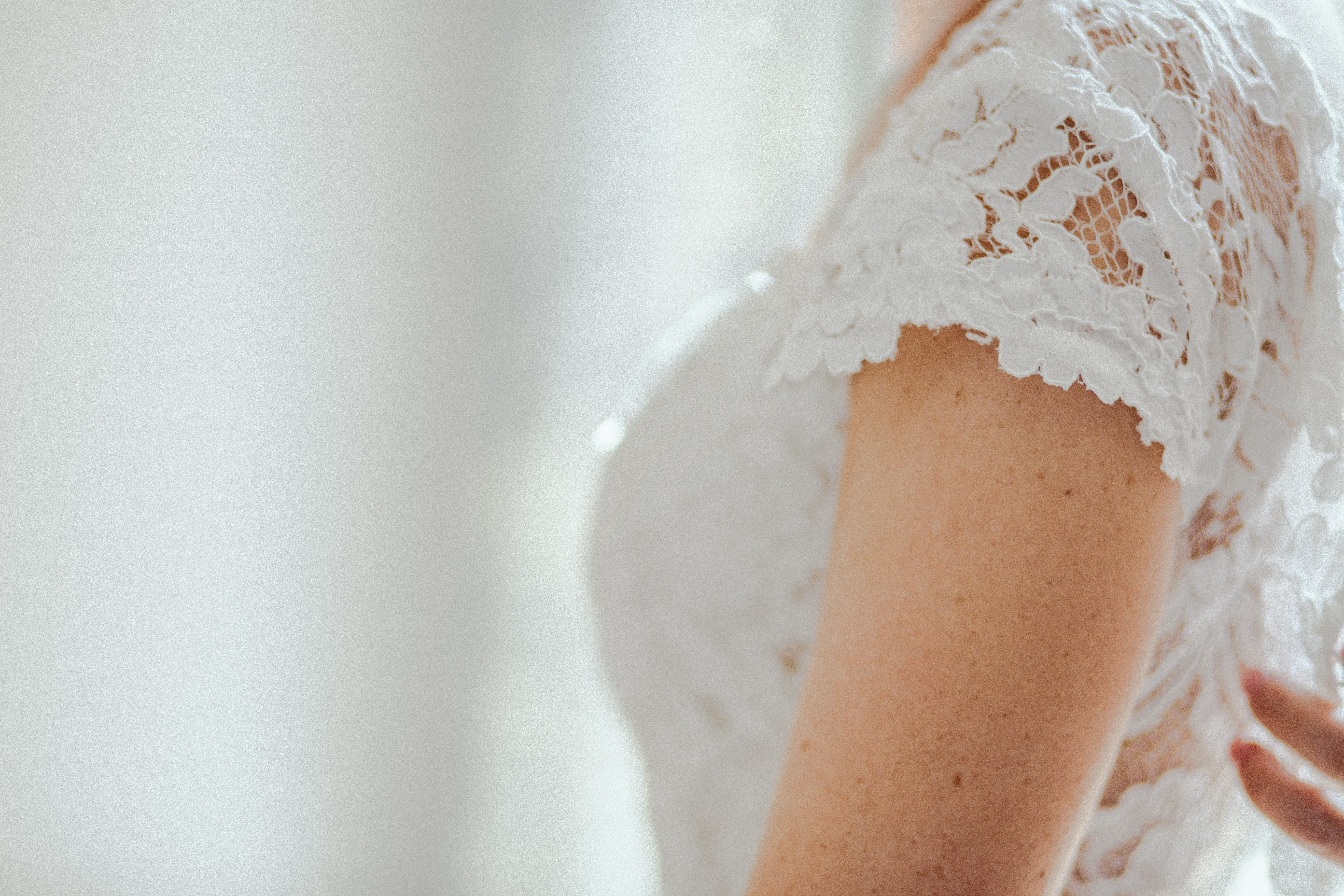 selective focus photo of woman wearing white lace top