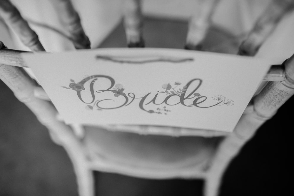 white wooden chair with Bride print