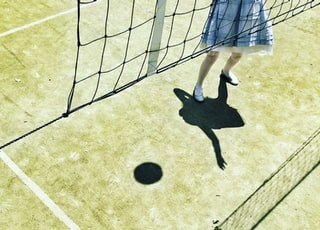 shadow reflection of girl playing volleyball