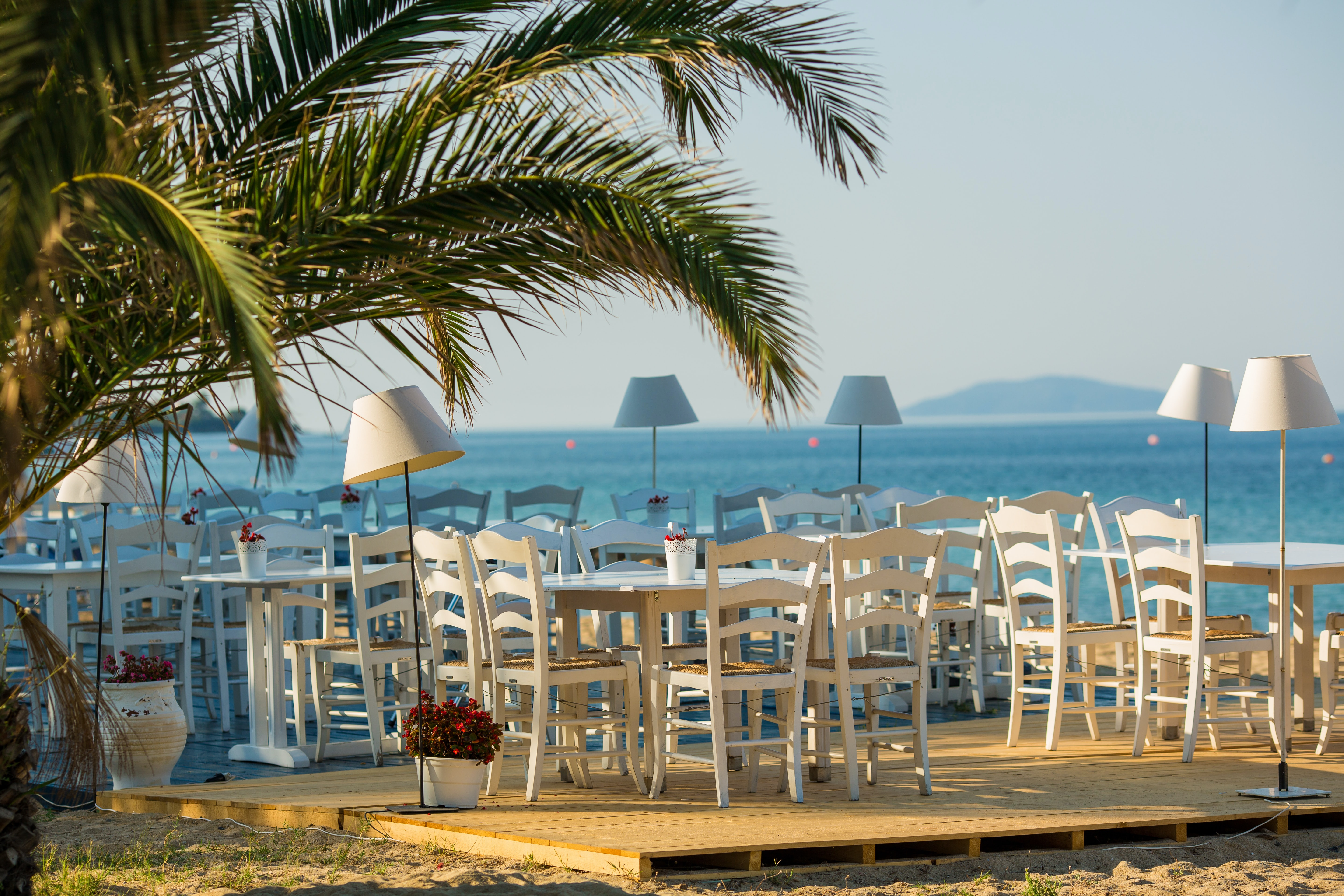 white wooden table and ladder back chairs
