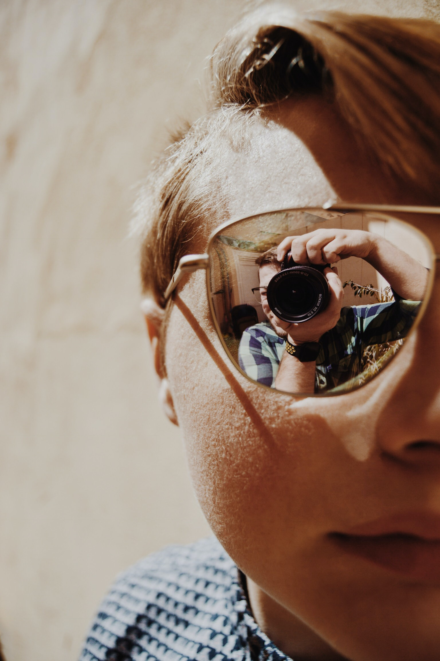 closeup photo of person wearing sunglasses