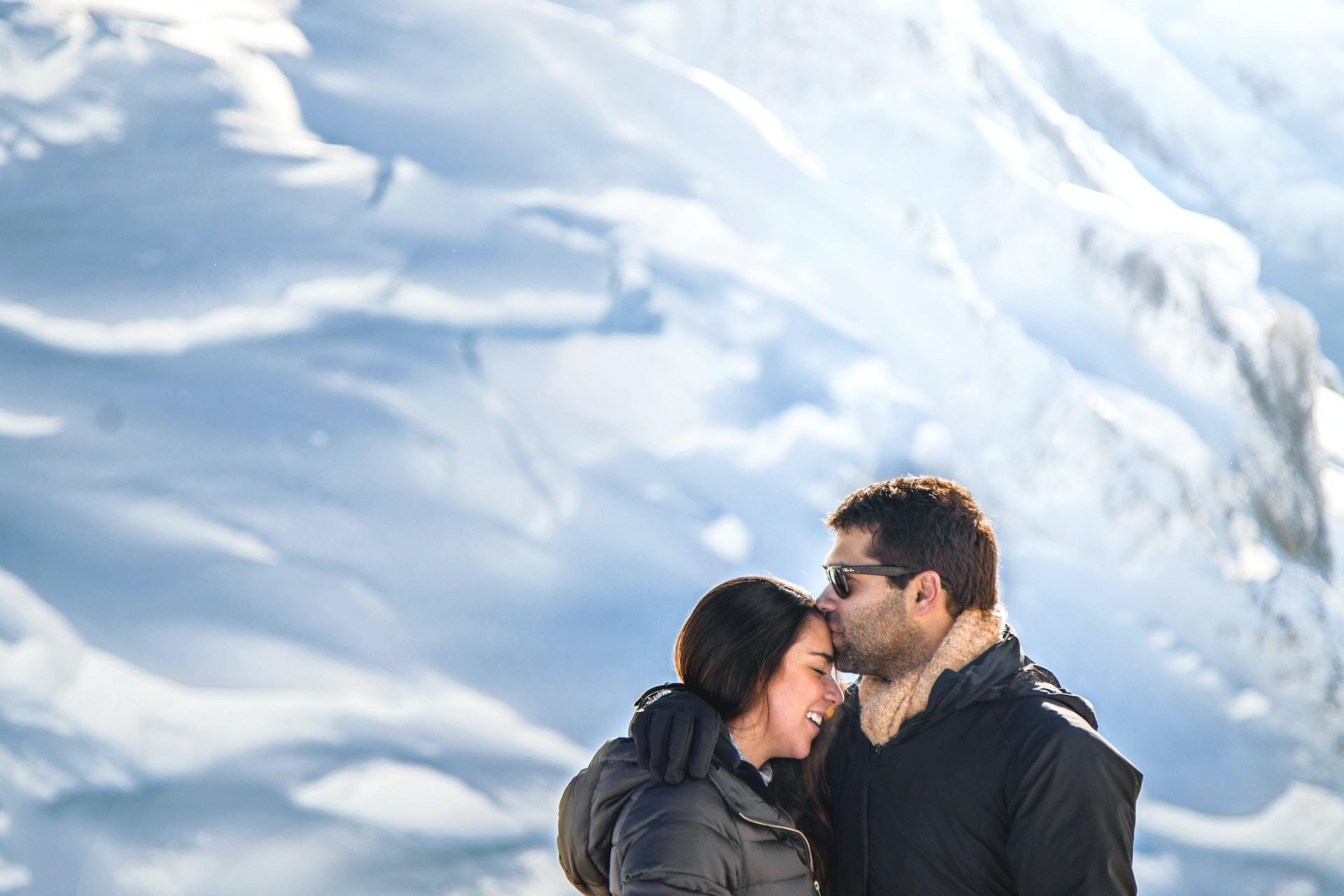 man kiss woman in forehead