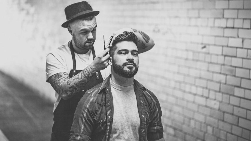 man trimming man's hair