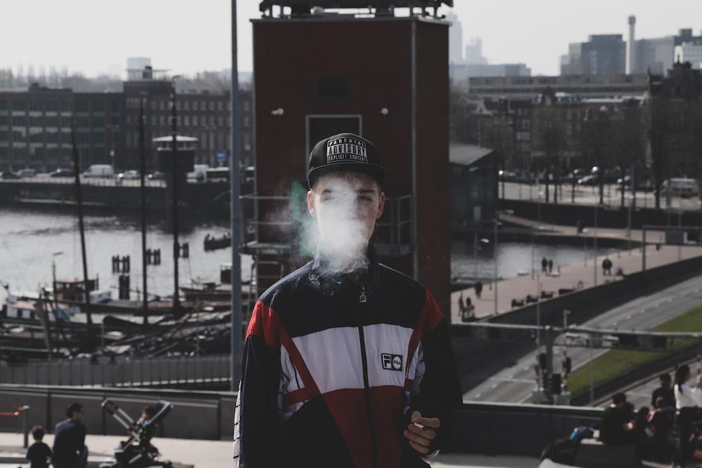 man standing while smoking