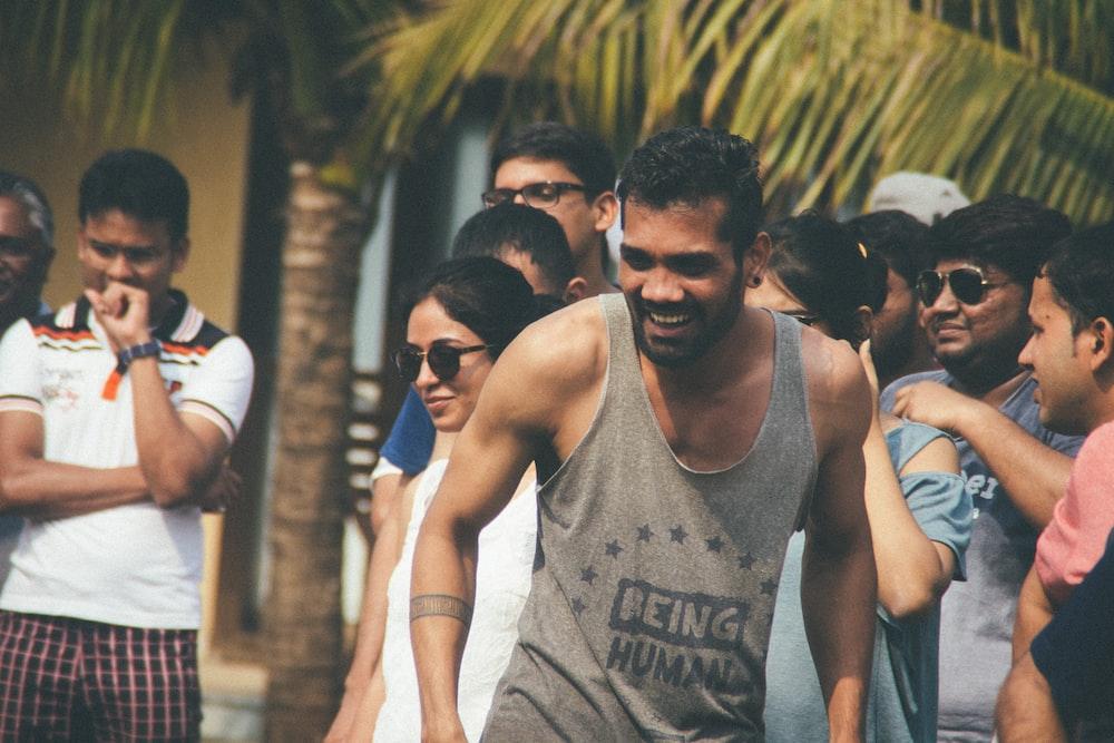 crowd near green coconut tree
