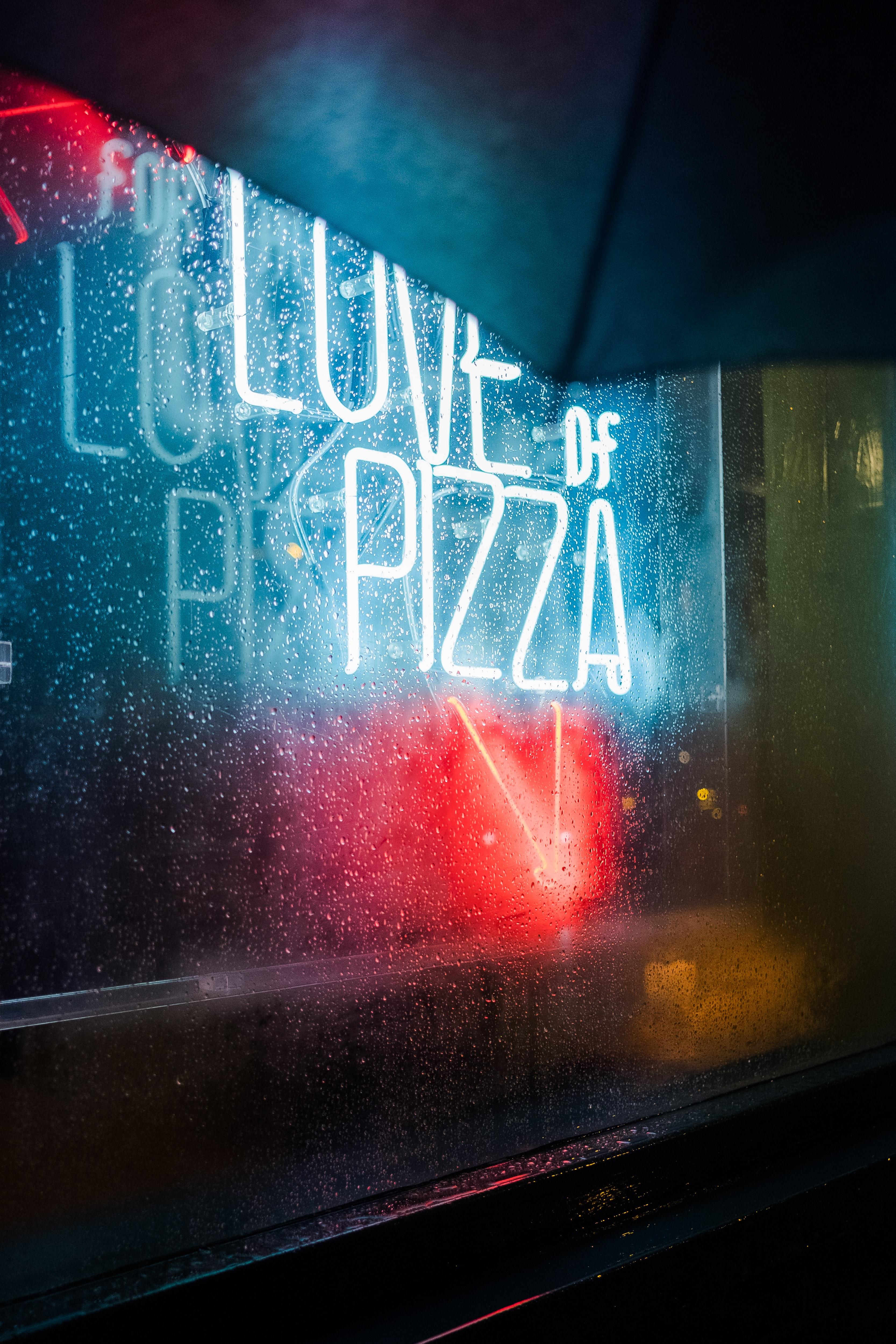 closeup photo of love of pizza neon light signage