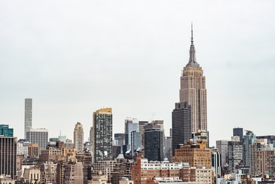 photo of empire state building during daytime cityscape teams background