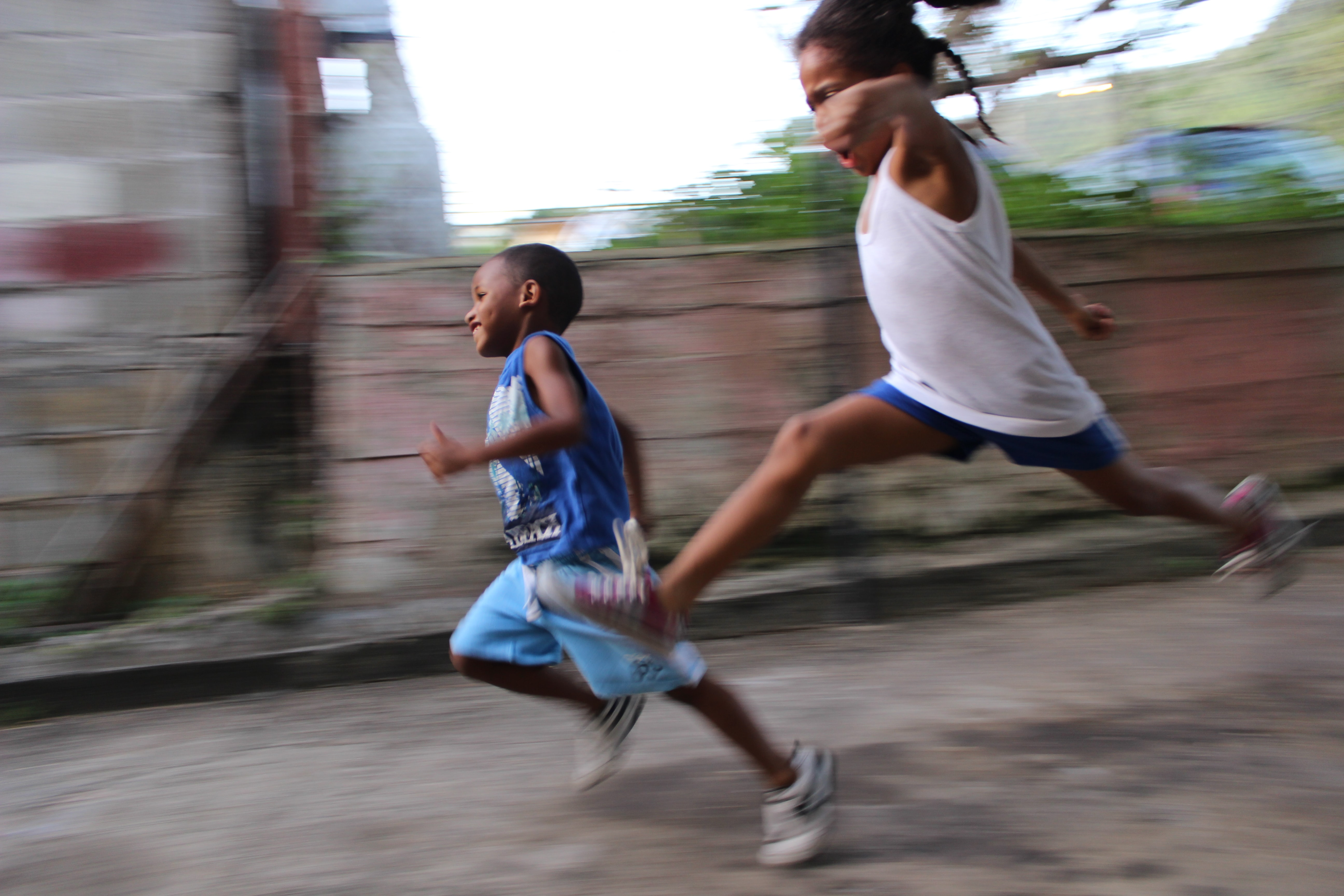 two children running during day time