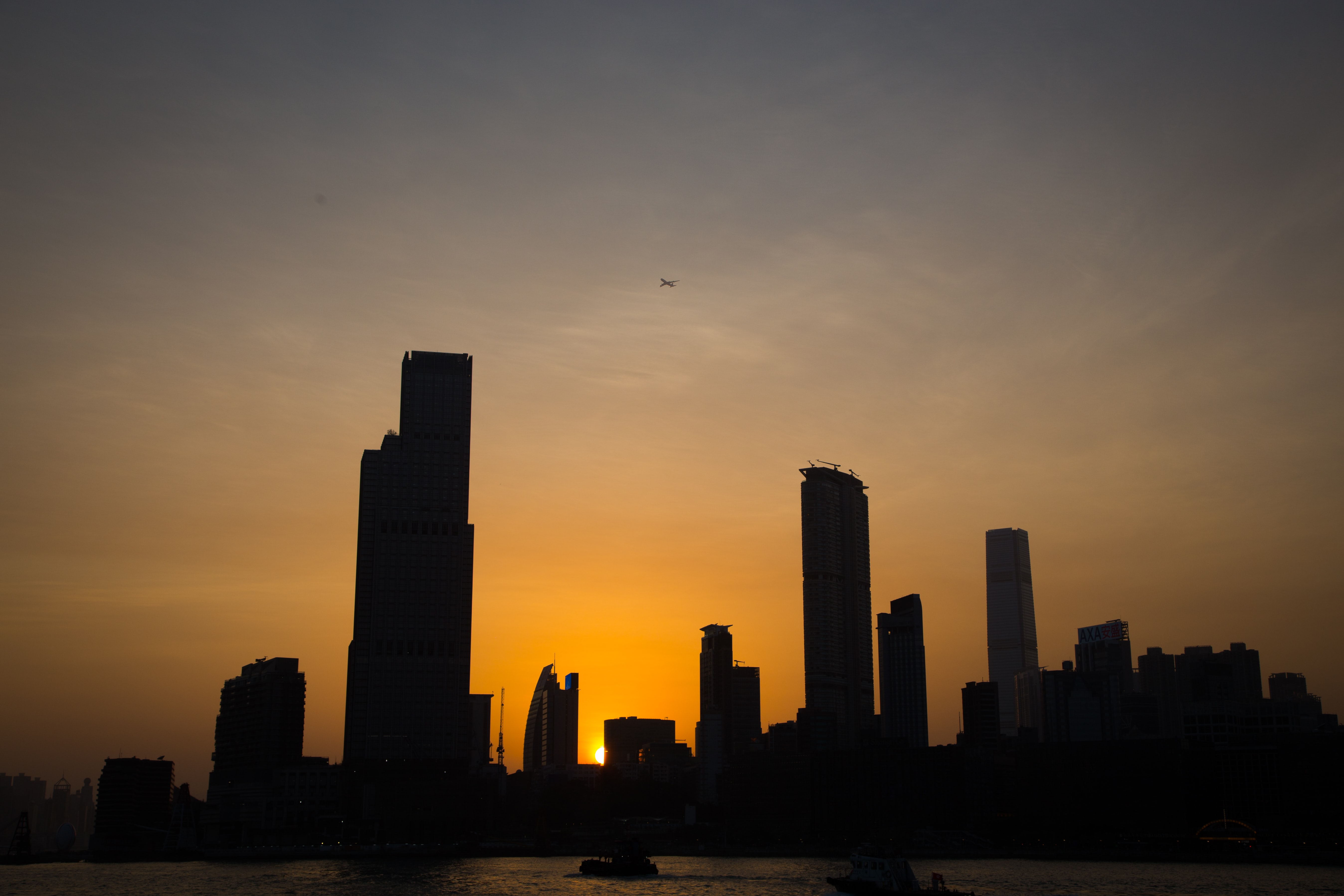silhouette photo of cityscape during golden hour
