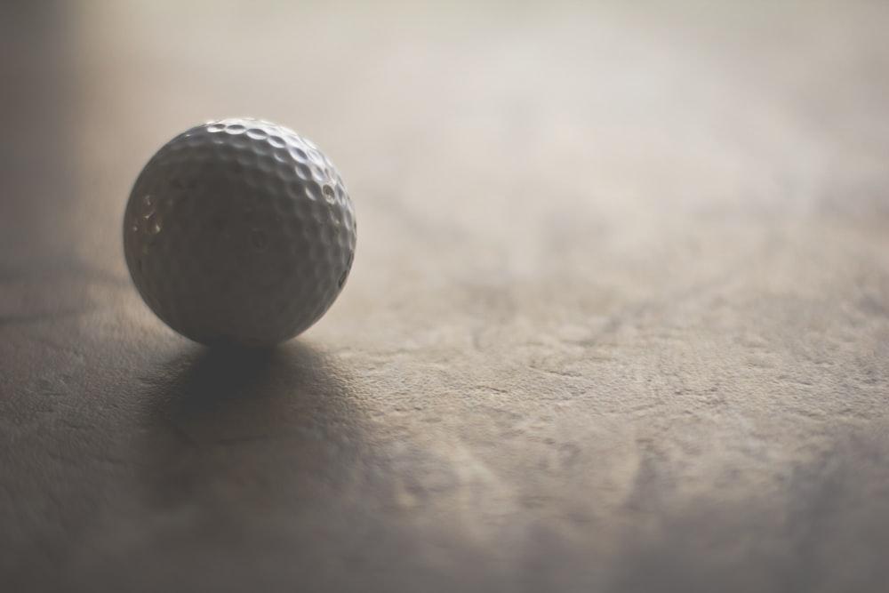 white golf ball on ground