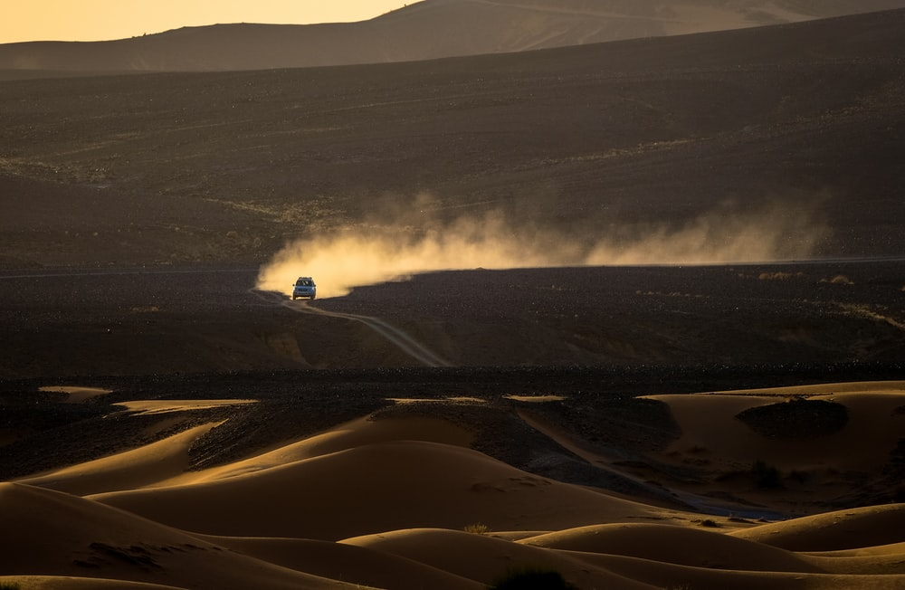 car traveling on desert