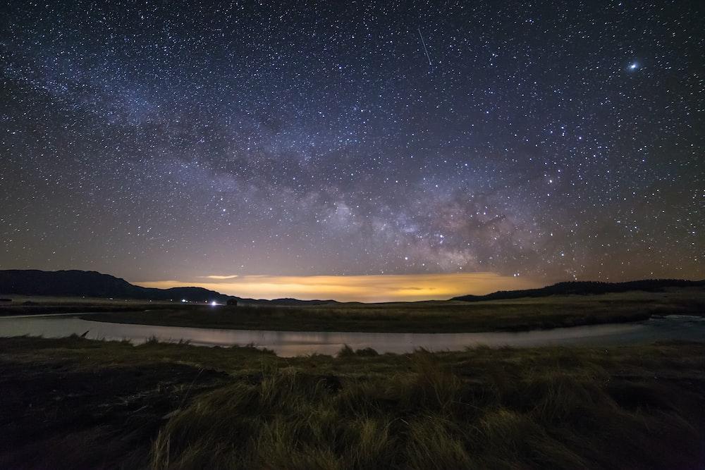 body of water under night sky
