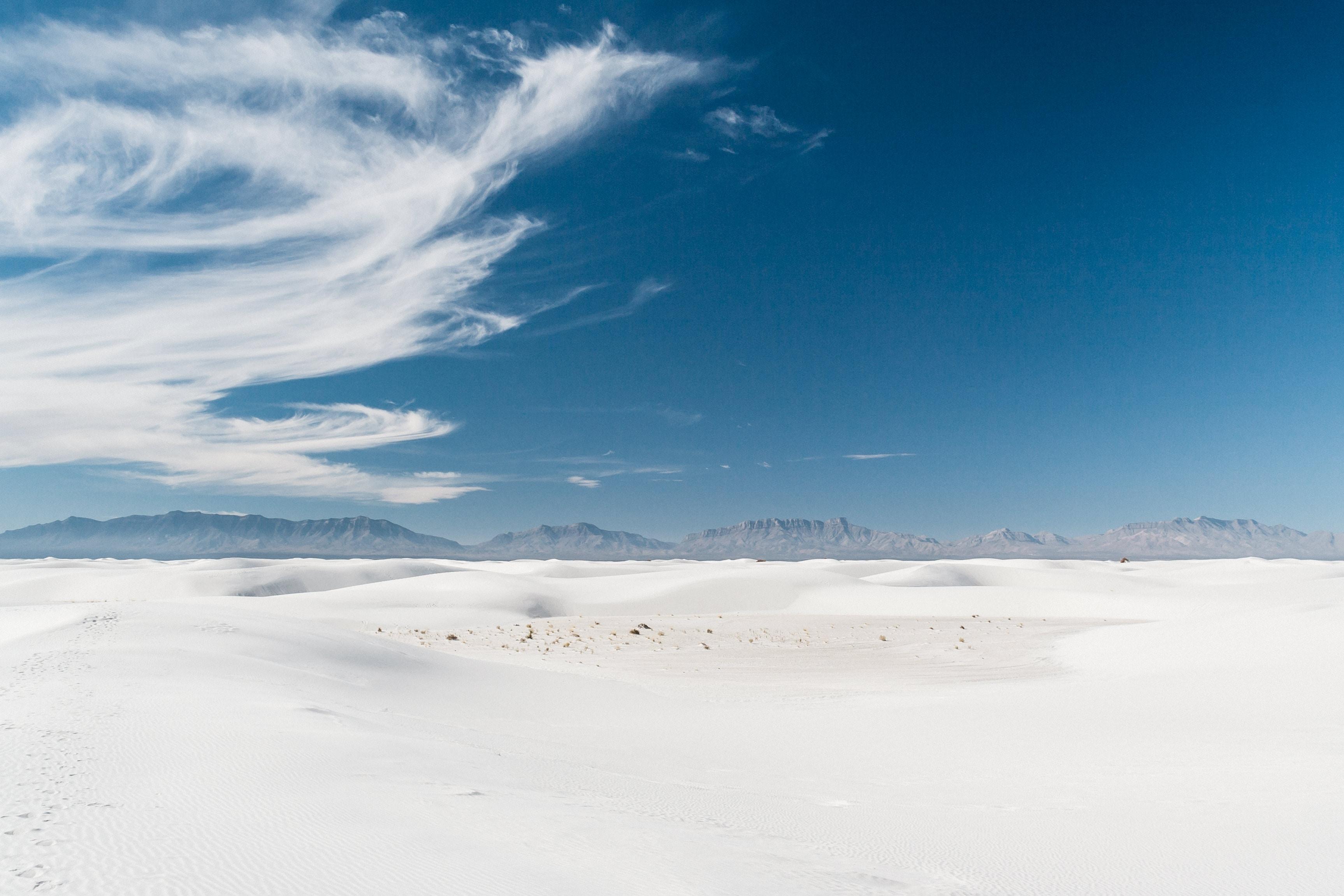 gray sand under blue sky