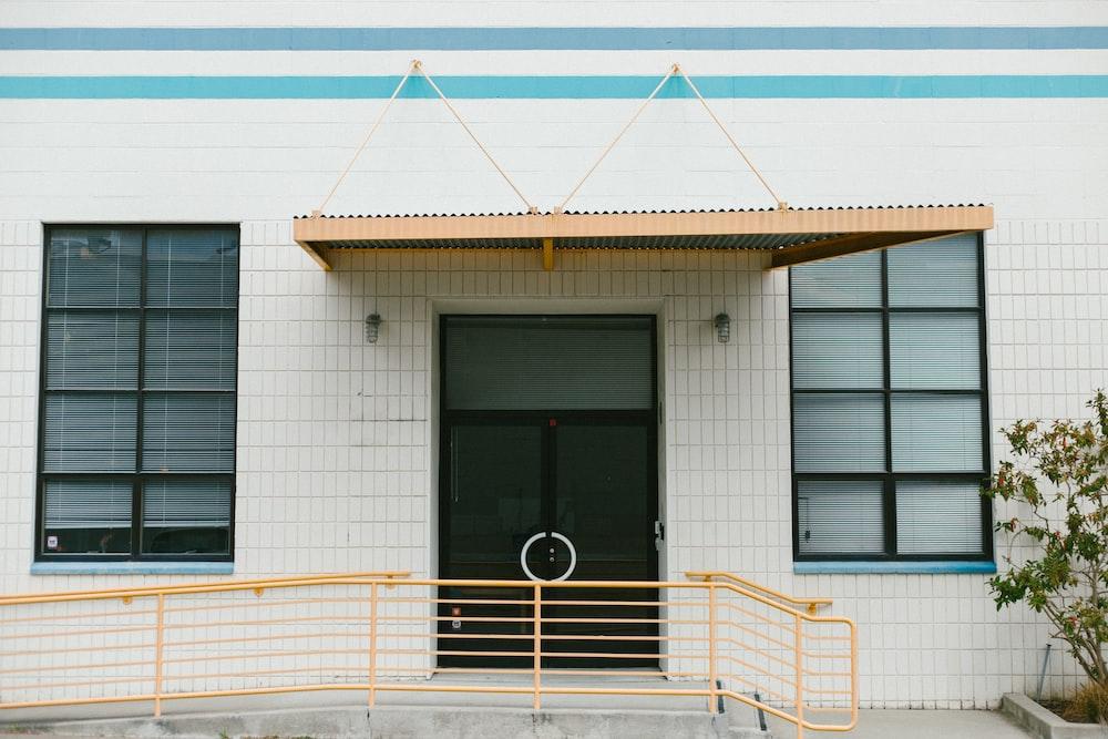 closed door of white concrete building