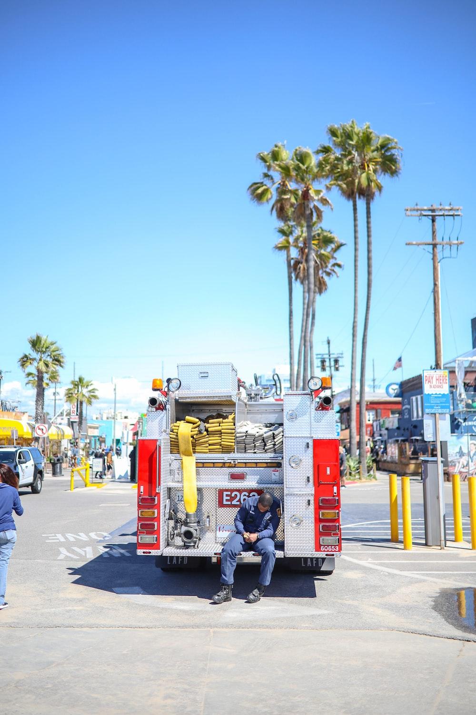 man sitting on fire truck