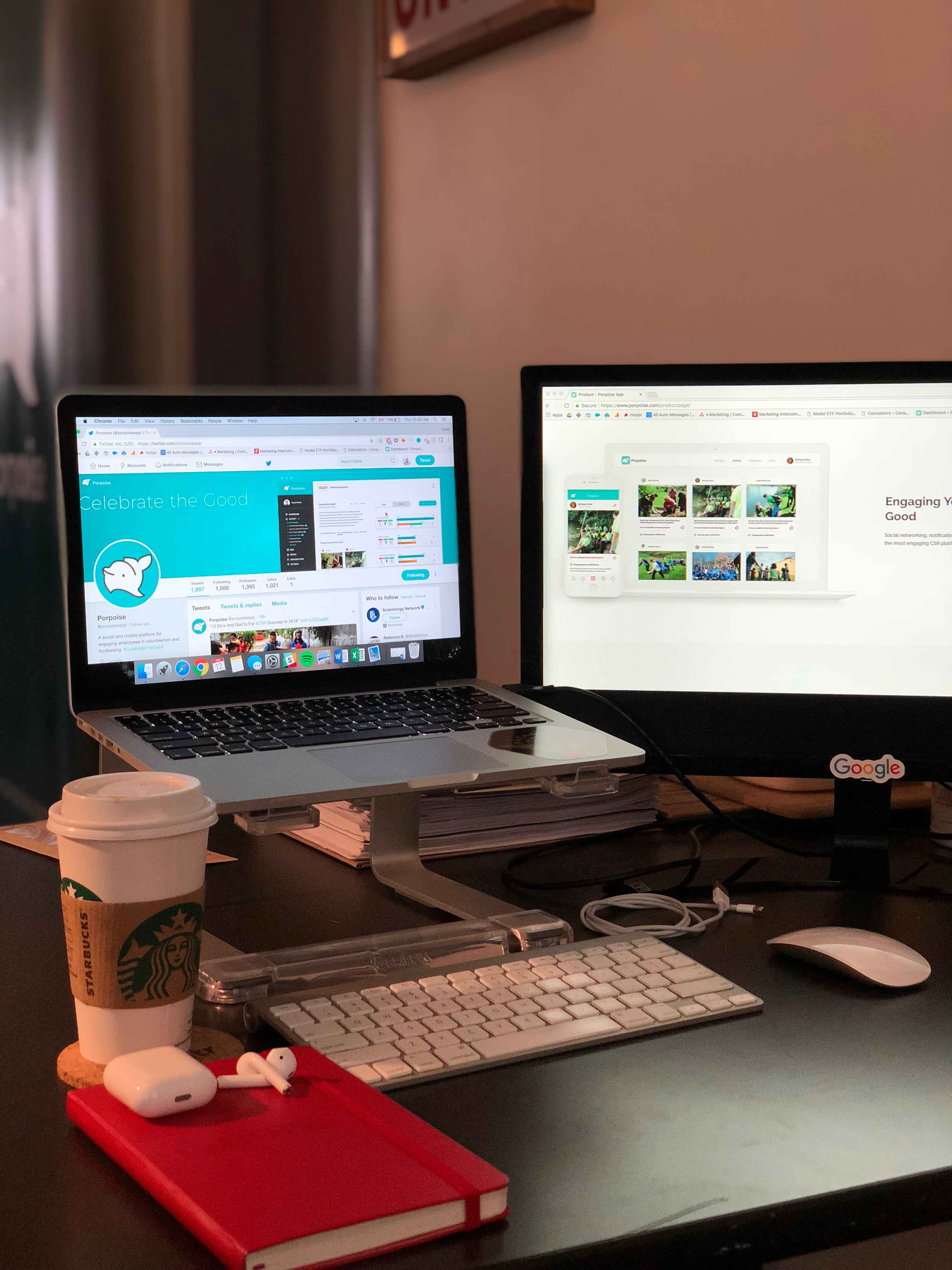 A picture of my desktop at my workplace, Porpoise. I love technology and coffee, and I have access to both all day at work!