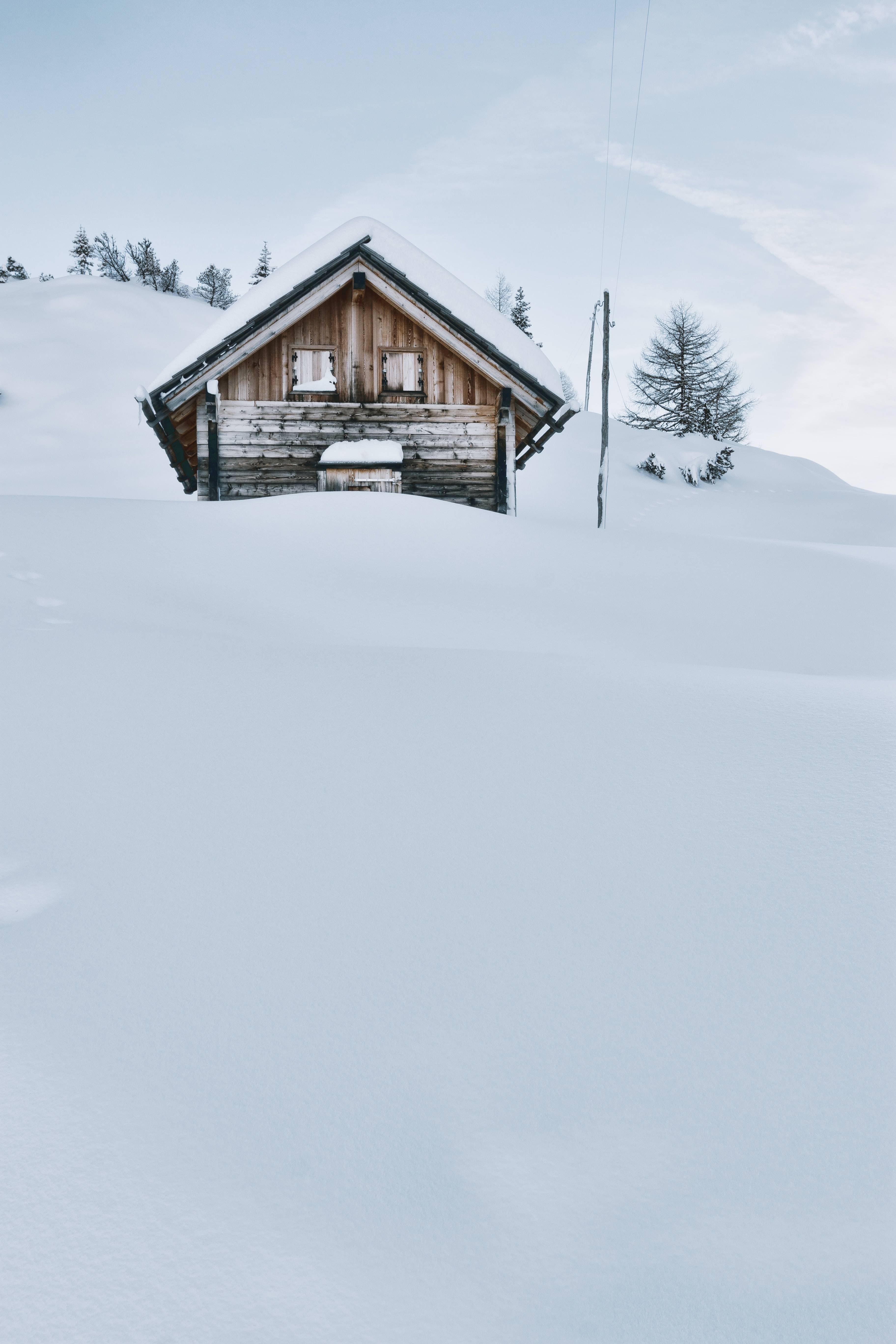 brown wooden cabin covered with snow