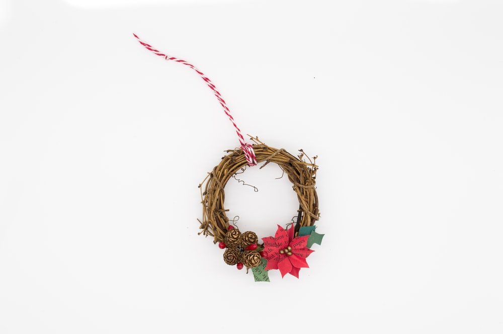 brown and red poinsettia wreath