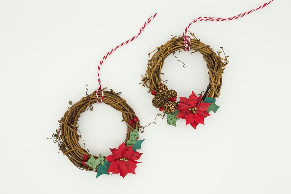 two poinsettia wreathes