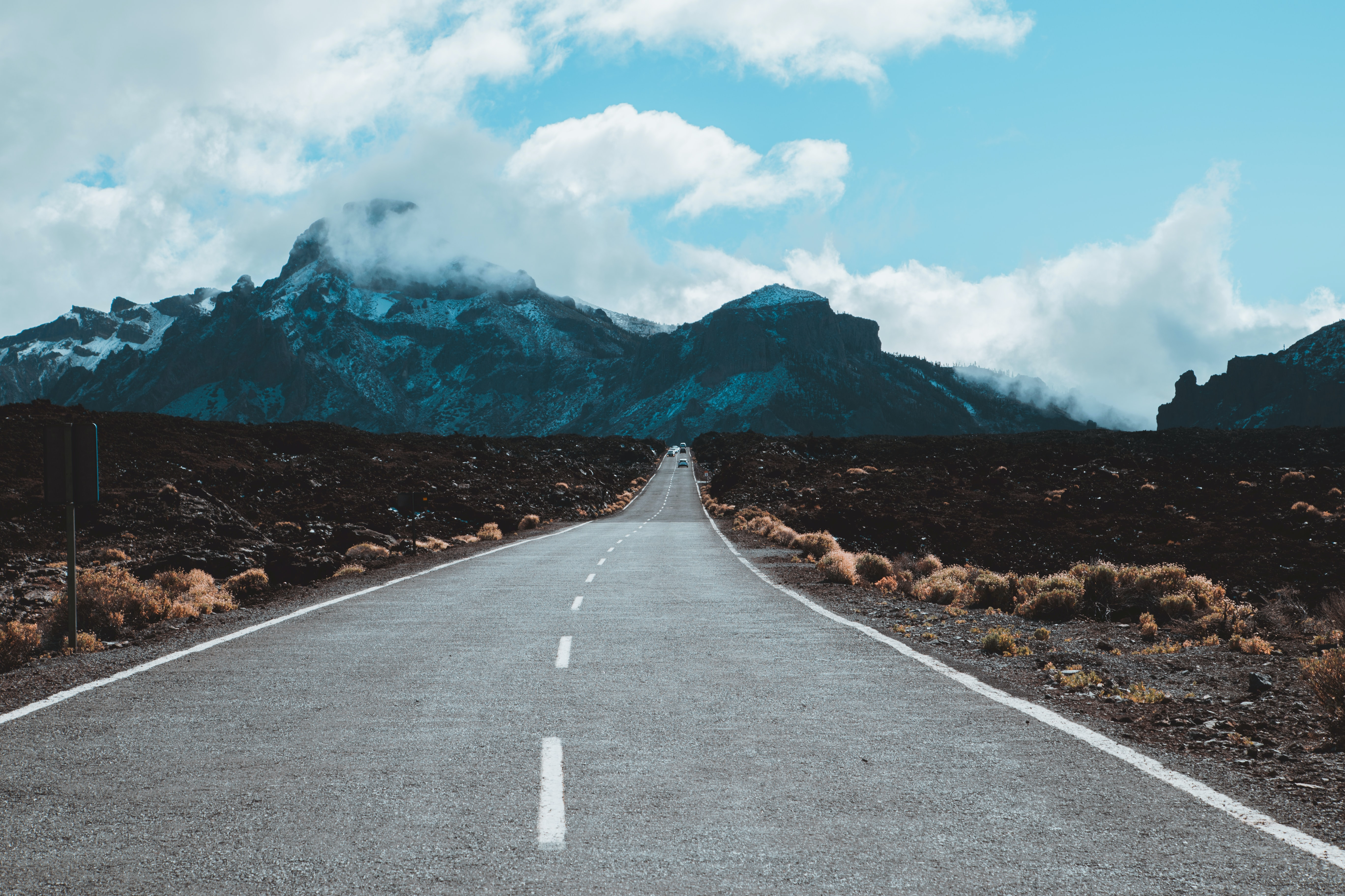 straight road leading to mountain