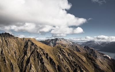 brown mountain ranges under white clouds