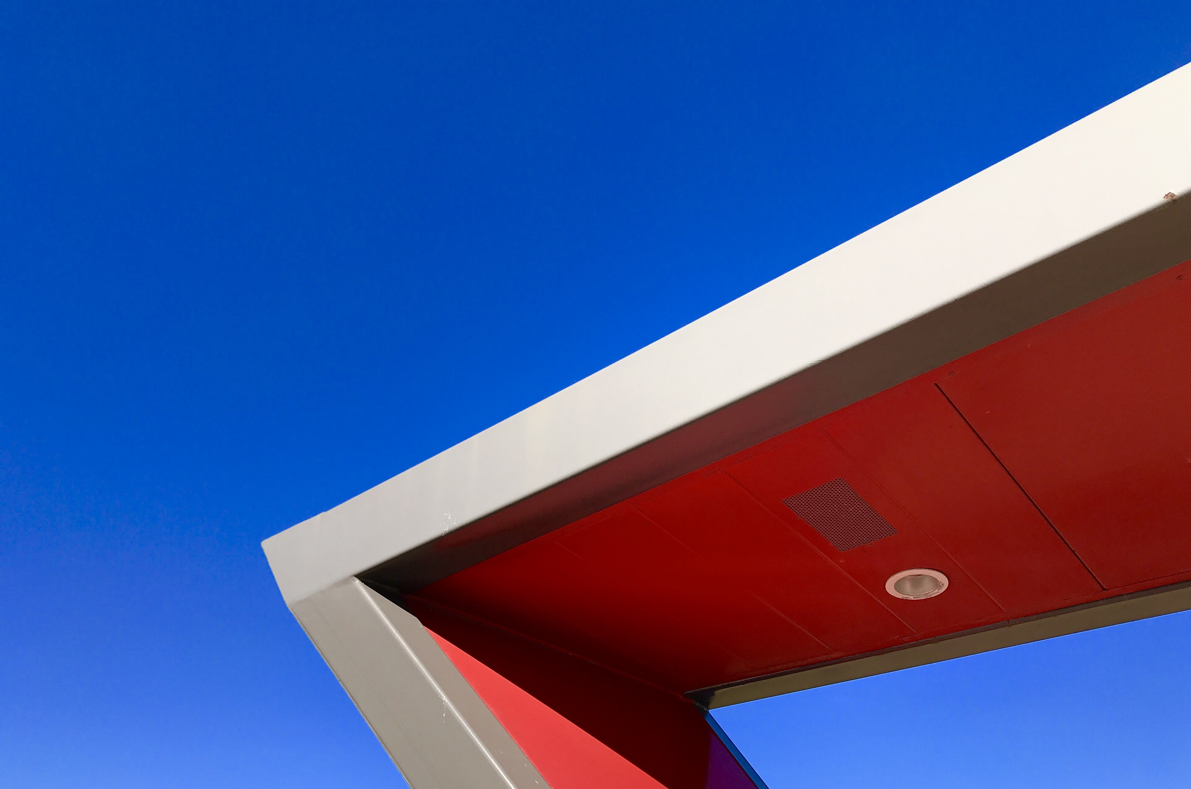 low-angle photography of red building