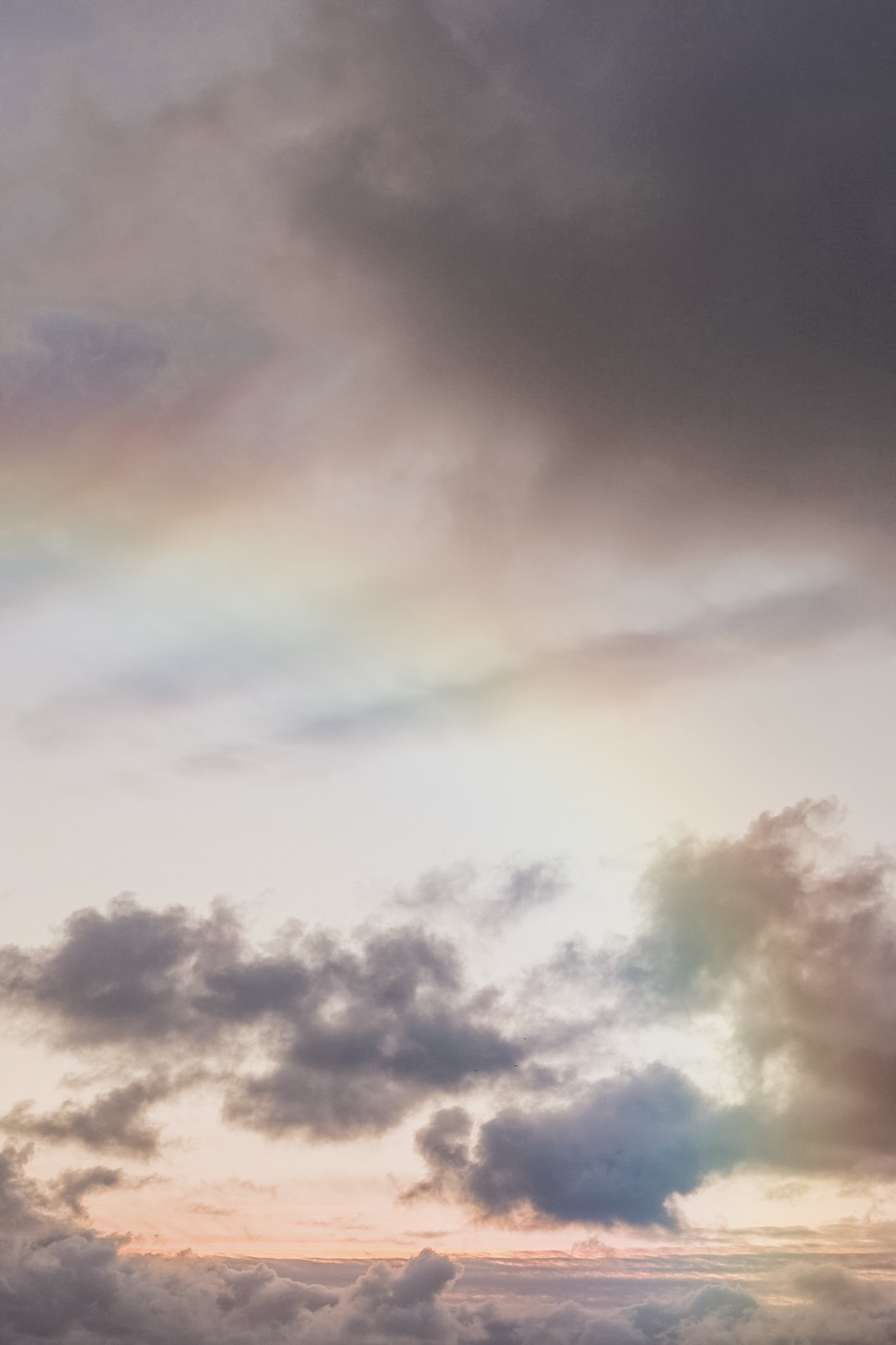 clouds against the rainbow