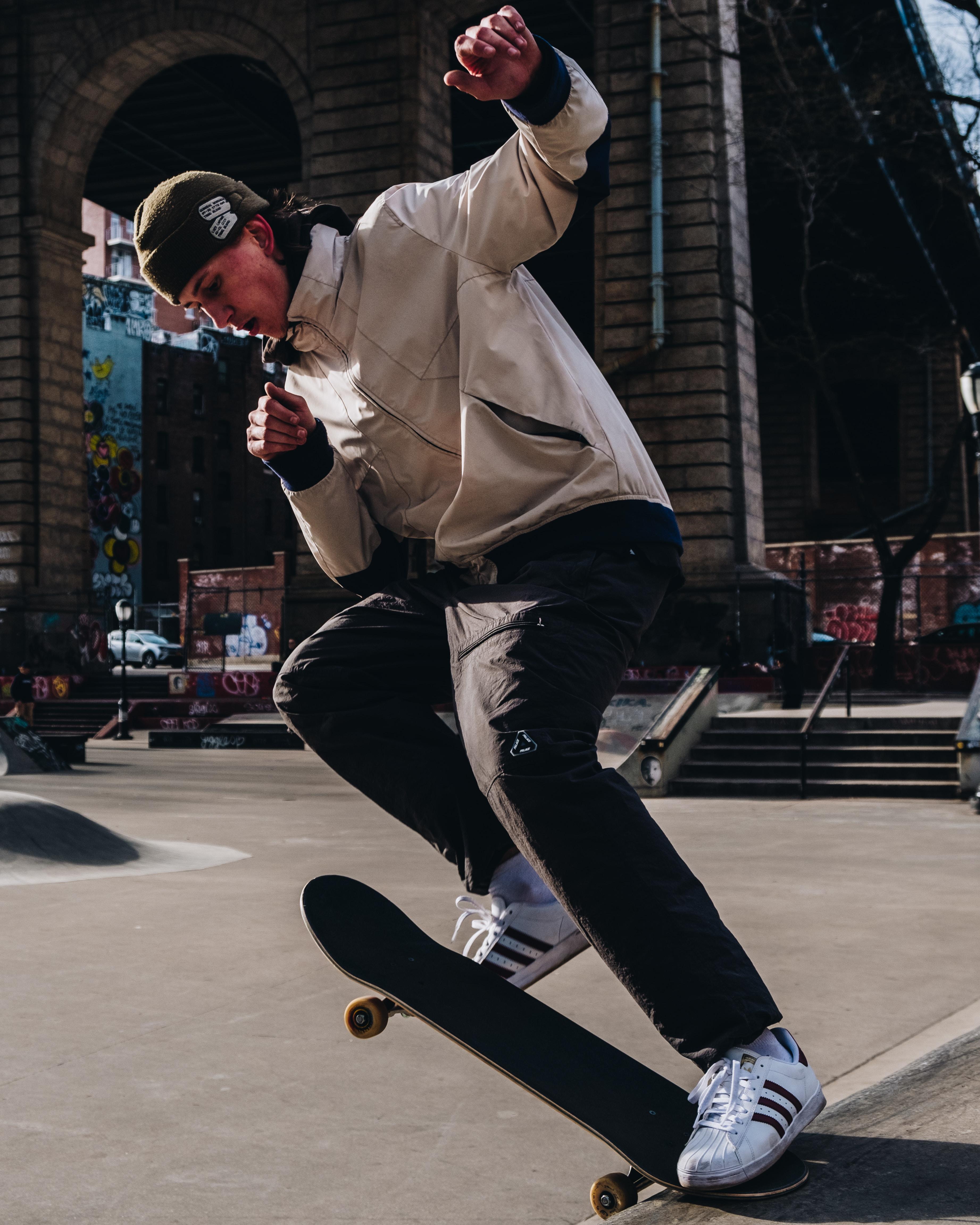 man playing skateboard on street