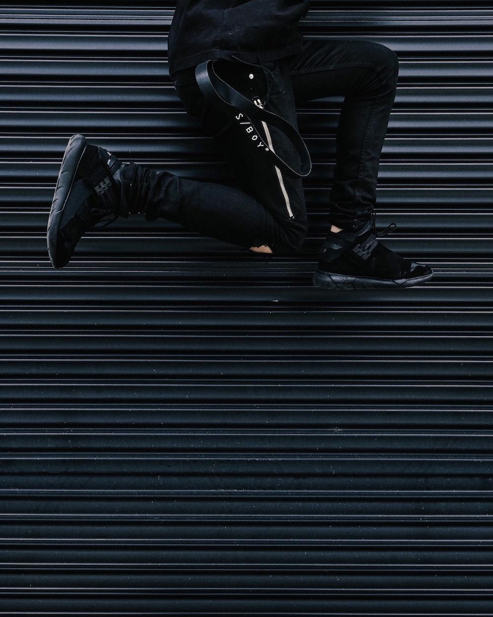 person jumping beside shutter roller