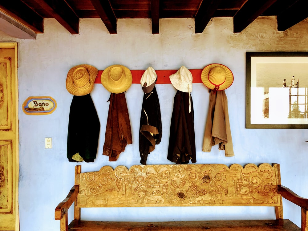 hats and coats hanging on the wall