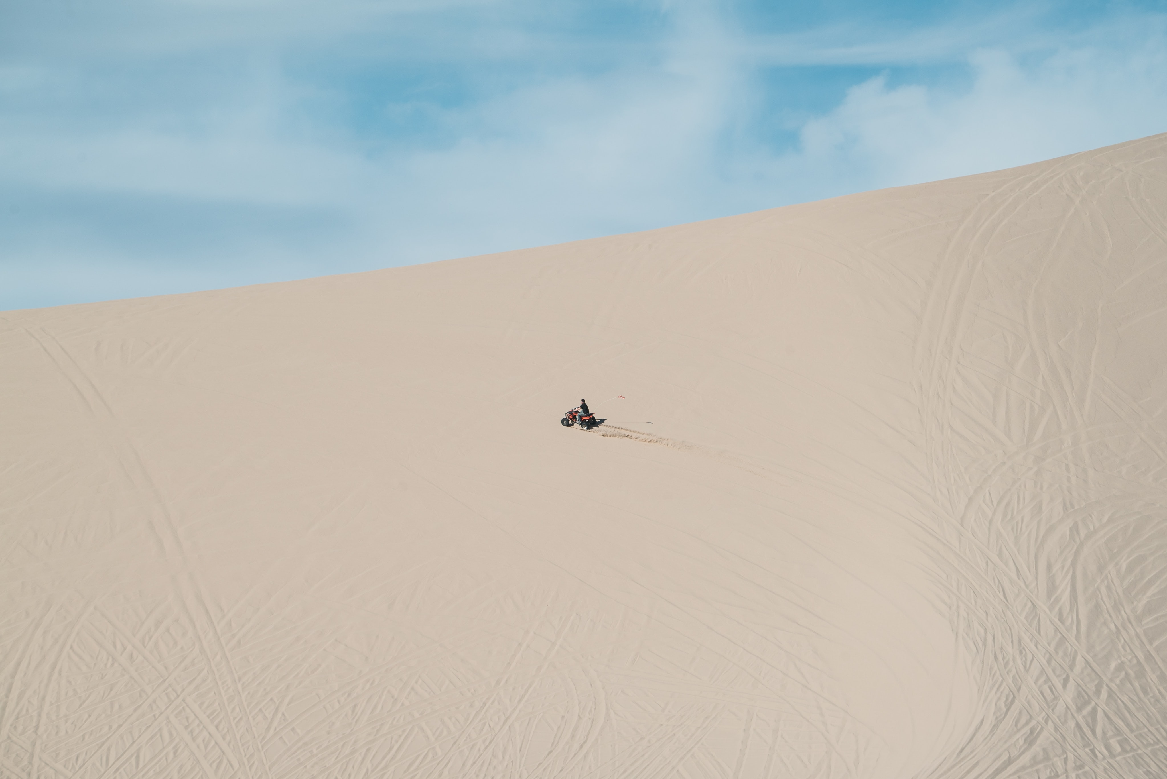 person riding motorcycle in the sand
