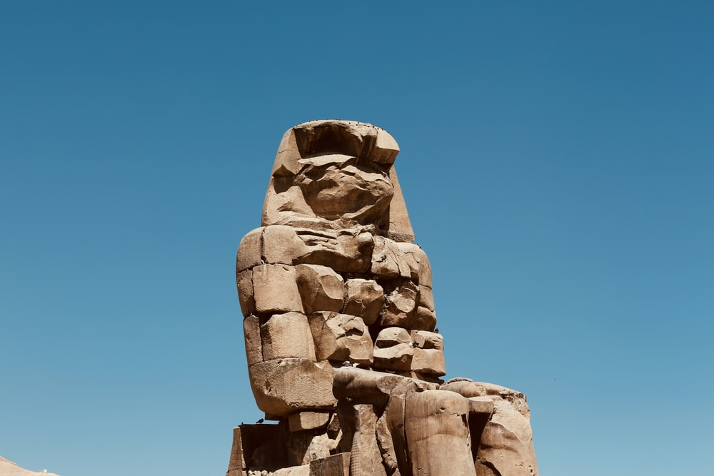 low angle photo of Egyptian God statue