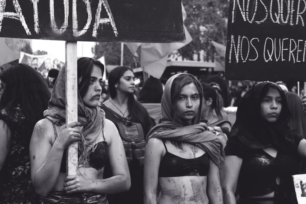 grayscale photography of women marching