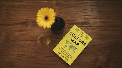 The Culture Map book beside flower