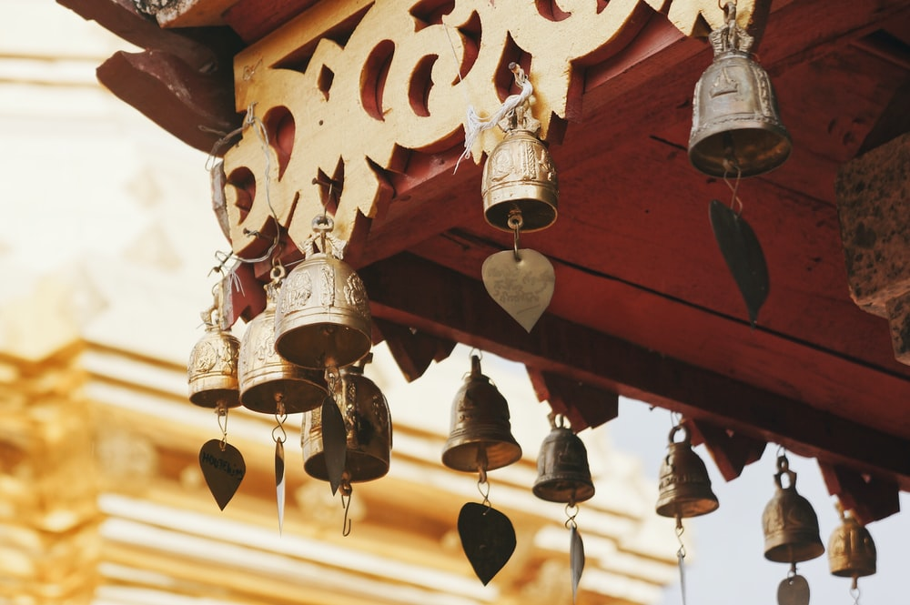 hanged brass-colored bells