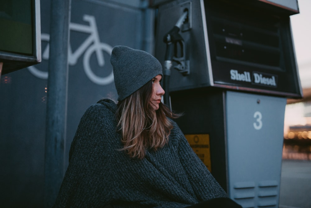 woman wearing black knit cap