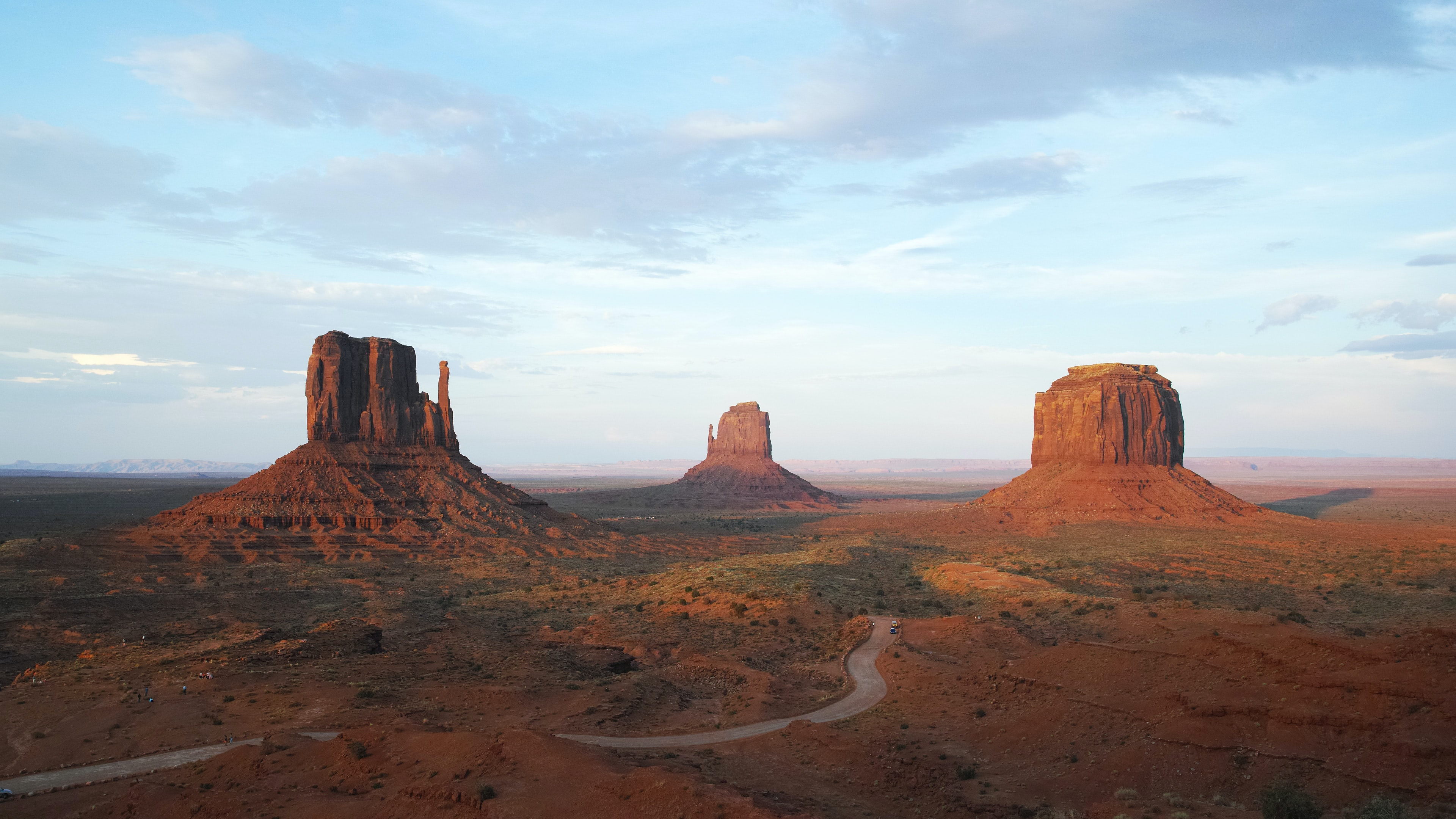 Monument Valley mountains under cumulus clouds